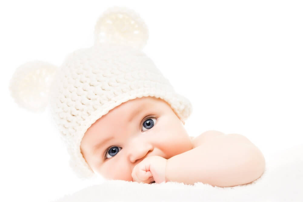Baby wearing a knit hat with bear ears